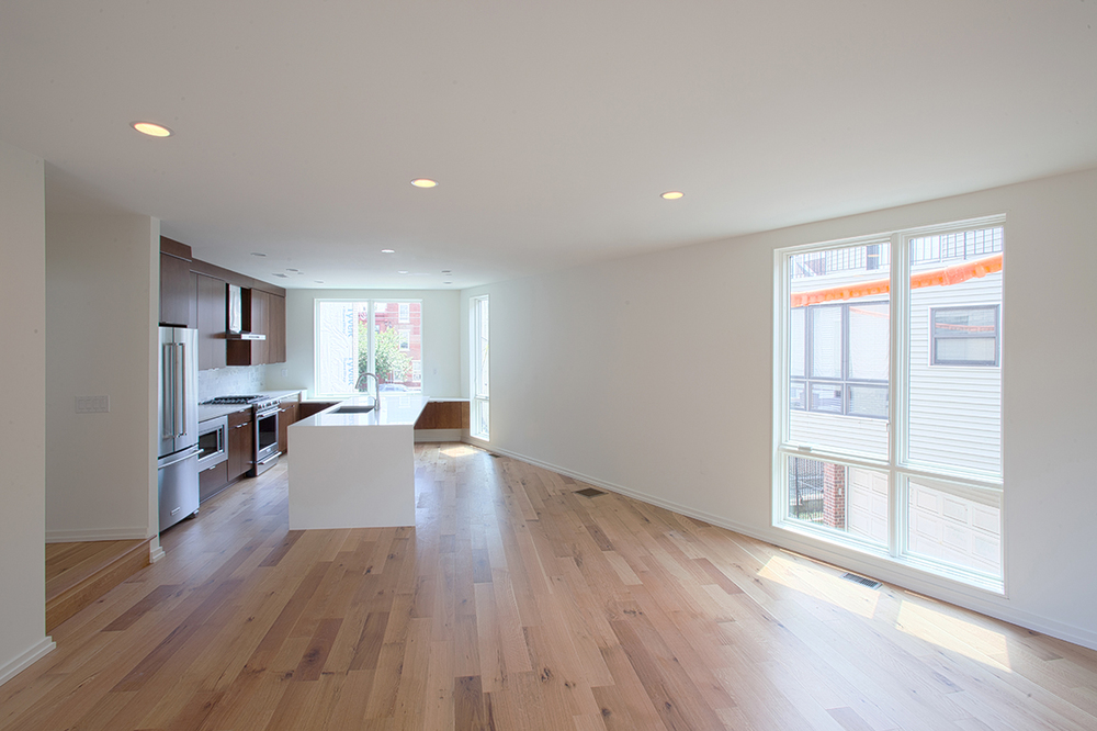 Wood floors run throughout the above grade living areas.