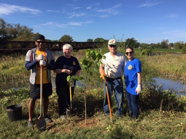Navin, Judy C., Ed and Navin's friend from Federal City Rotary Club plan a planting.
