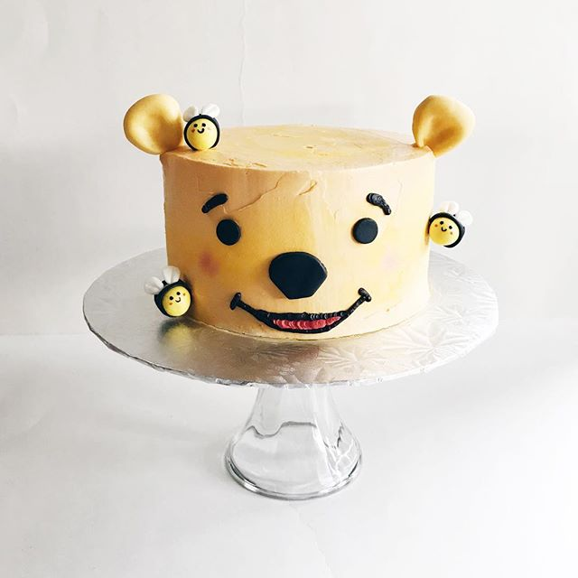 """""""It is more fun to talk with someone who doesn't use long, difficult words but rather short, easy words like, """"What about lunch?"""" 🐻🐝 . .  3.6.18 - CAKE#2 Winnie the Pooh Mango Chiffon Cake with Mango Bavarian cream and Mango chunks. Mangoes are so sweet this season! I loved making those tiny little bees around Pooh's face. 🐝 So you guys ever remember Pooh ever getting stung by bees in the show? It's been so long since I've watched that show. . . . . . . #cake #cakeart #mango #pooh #winniethepooh #poohbear #bee #🐻 #🐝 #chiffoncake #mangocake #vscocam #foodart #foodvsco #sanjose #bayarea #bakedgoods #bakerlife #lydiabakedit #poohcake #fondant #cakeartistry #mangoeveryday"""