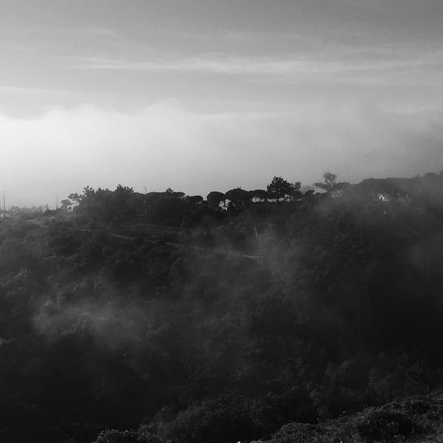 Low clouds over the coastline near Cascais  #cascais #clouds #cloudbank #portugal #landscape #landscapephotography #bnw #fog #foggy #sunset #sunset_pics #silhouette #travel