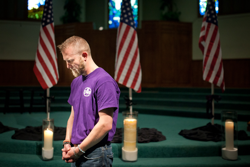 Retired Marine corpsman Nick Lowry, of Victoria, takes a moment of silence during a prayer vigil at Northside Baptist Church in Victoria to honor victims of a shooting