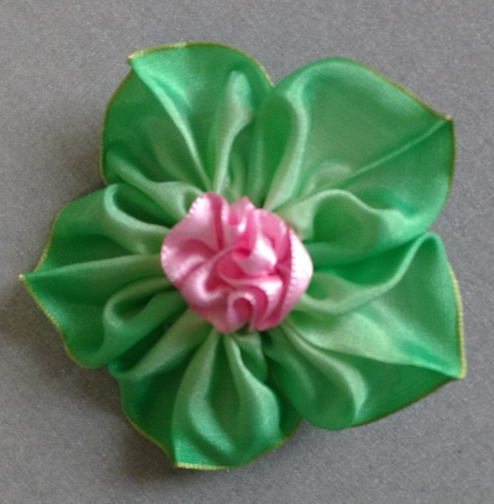 pink green ribbon flower