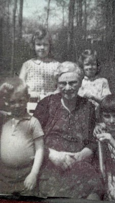 My beloved Grandma Catie. She was an Irish immigrant and tremendously faithful woman. That's me, behind her on the left.