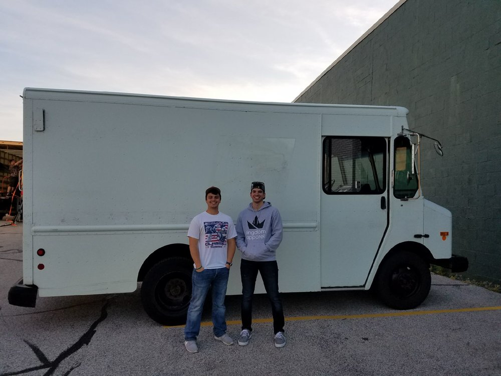 Joey (left) and Billy (right) pose for a picture with their first truck before they transformed it into Lake County's first ever mobile retail truck. April 2017.
