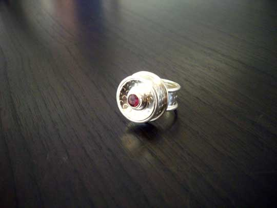 Ring,   sterling silver and garnet,   sold