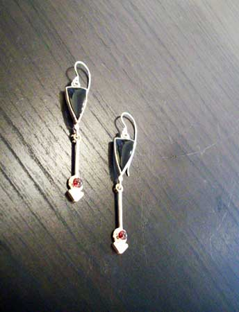 Earrings,   sterling silver, 14k gold, black onyx and garnet,   sold