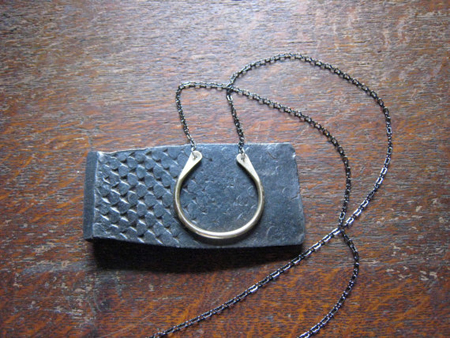 Large Brass U-Bone Necklace,   brass, gun metal chain, sterling silver,   $65