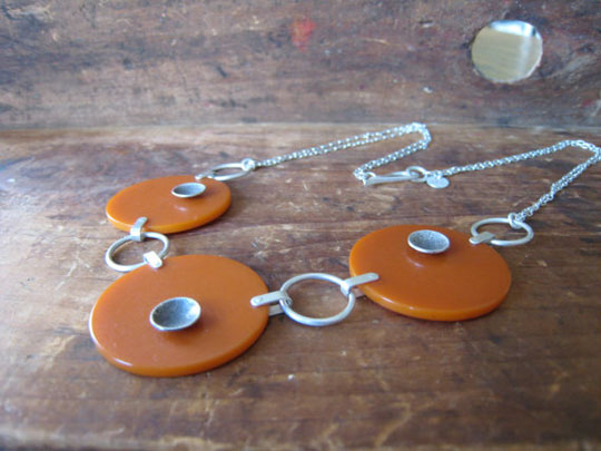 Time & Space Multiplied bakelite necklace,   pumpkin bakelite with sterling silver saucers, sterling silver chain