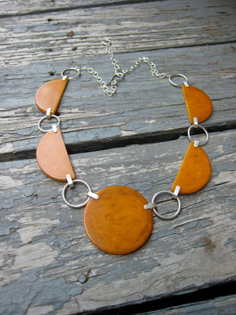 Circles & Crescents bakelite necklace,   marbled orange bakelite, riveted rings, sterling silver chain