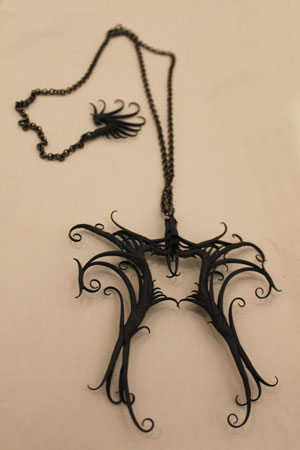 hyper baroque double pendant necklace,   black rubber, aluminum armatures, brass gunmetal chain ,  sold