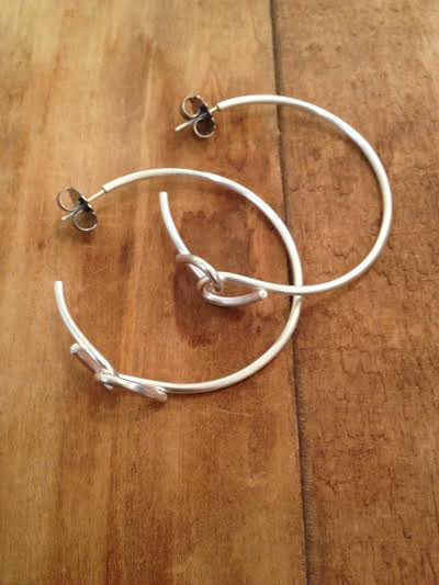 Forget-me-knot plain hoops  , sterling silver, $85