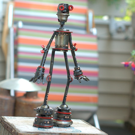 "Remi,   Castillo-class astrobot #234, repurposed bicycle parts,disc lock, wing nuts, rotating head, red racing stripes, 14½"" x 8½"" x 3"", sold"