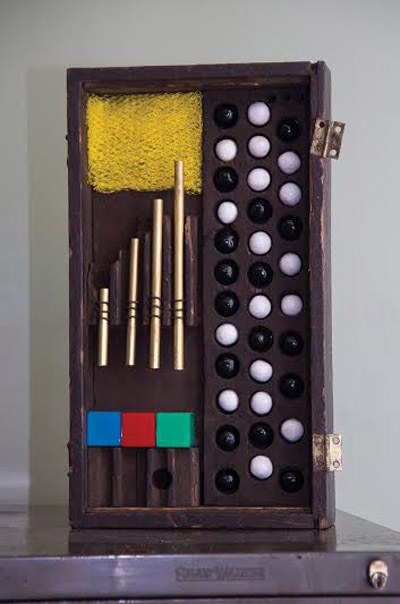 "Rakengro , Cortney Leigh Cox, found wooden drawer, clay, enamel, brass tubing, hardware, found plastic game cubes, colored acetate, plastic onion bag, 16"" x 9"" x 3"", $525"