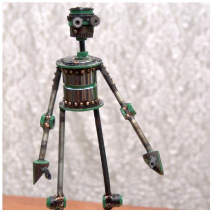"""Allen #265,  Castillo-class astrobot, bicycle parts, piston valves, copper, bronze, enamel,17½"""" x 6½"""" x 3½″, $350"""