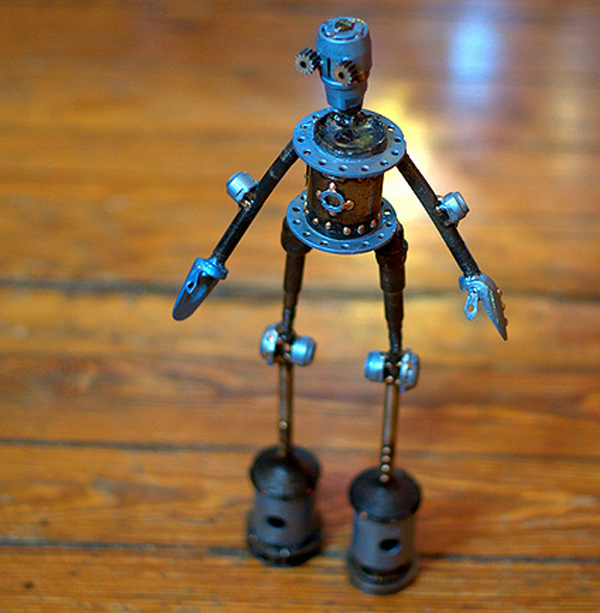 "Danaan #269 , Castillo-class astrobot,bicycle parts, piston valves, hole saws, copper, bronze, enamel, 15 ½ "" x 7"" x 3"", $350"