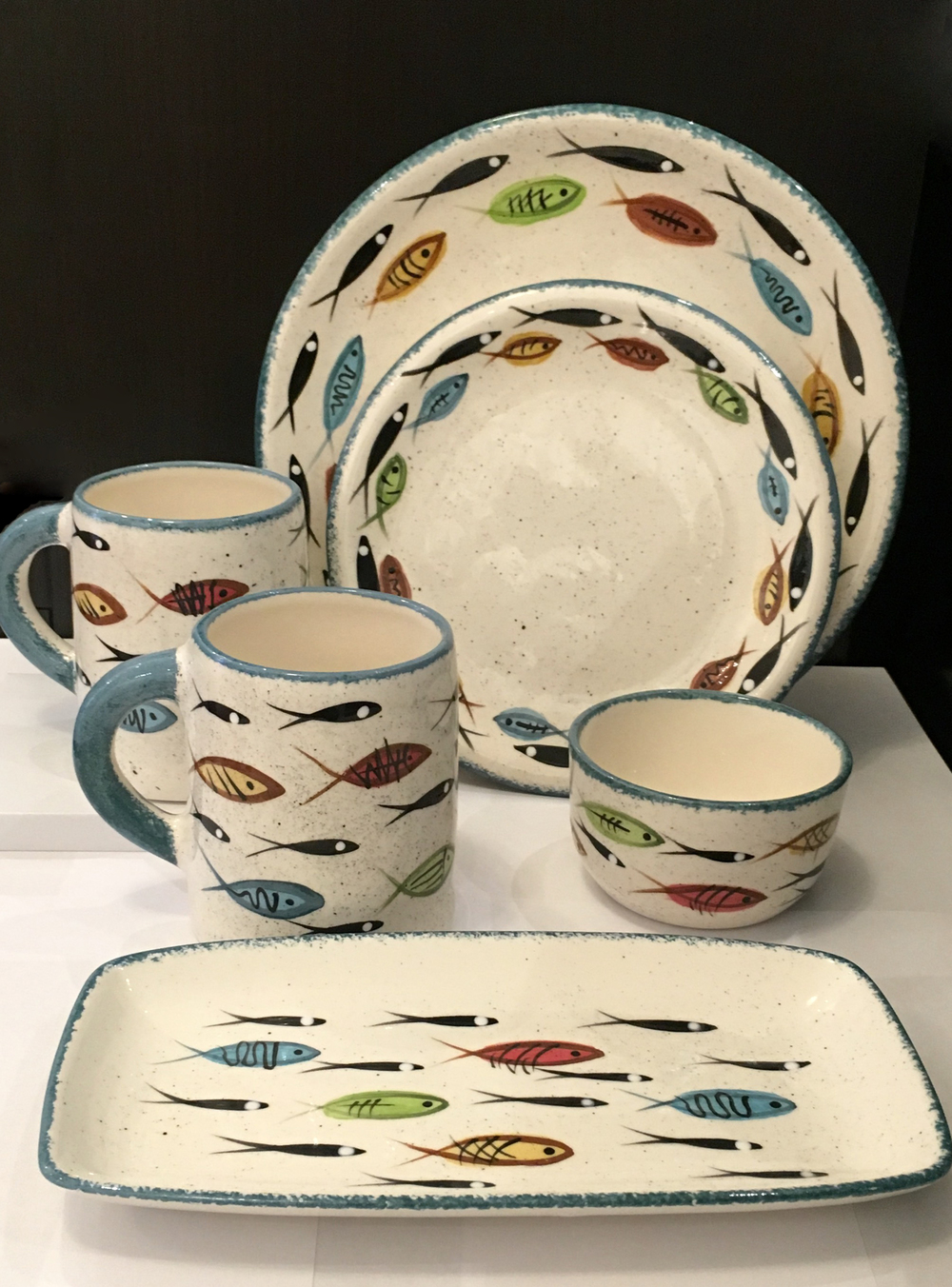 Mugs, dinnerware, rice bowl and pastry tray in traditional multifish pattern, $28-$58
