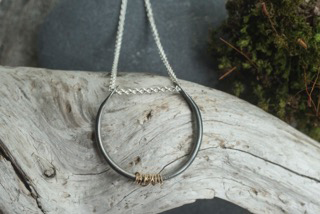 Eden horseshoe  necklace, blackened silver and woven 18k gold, $145