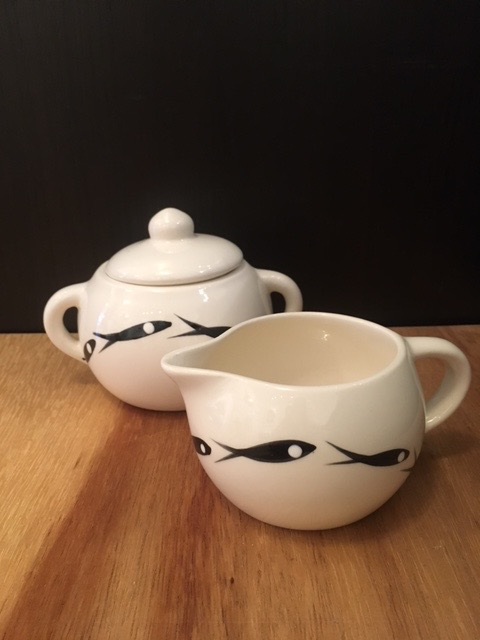 Sugar bowl, ceramic, black and white, $45; creamer, ceramic, black and white, $40