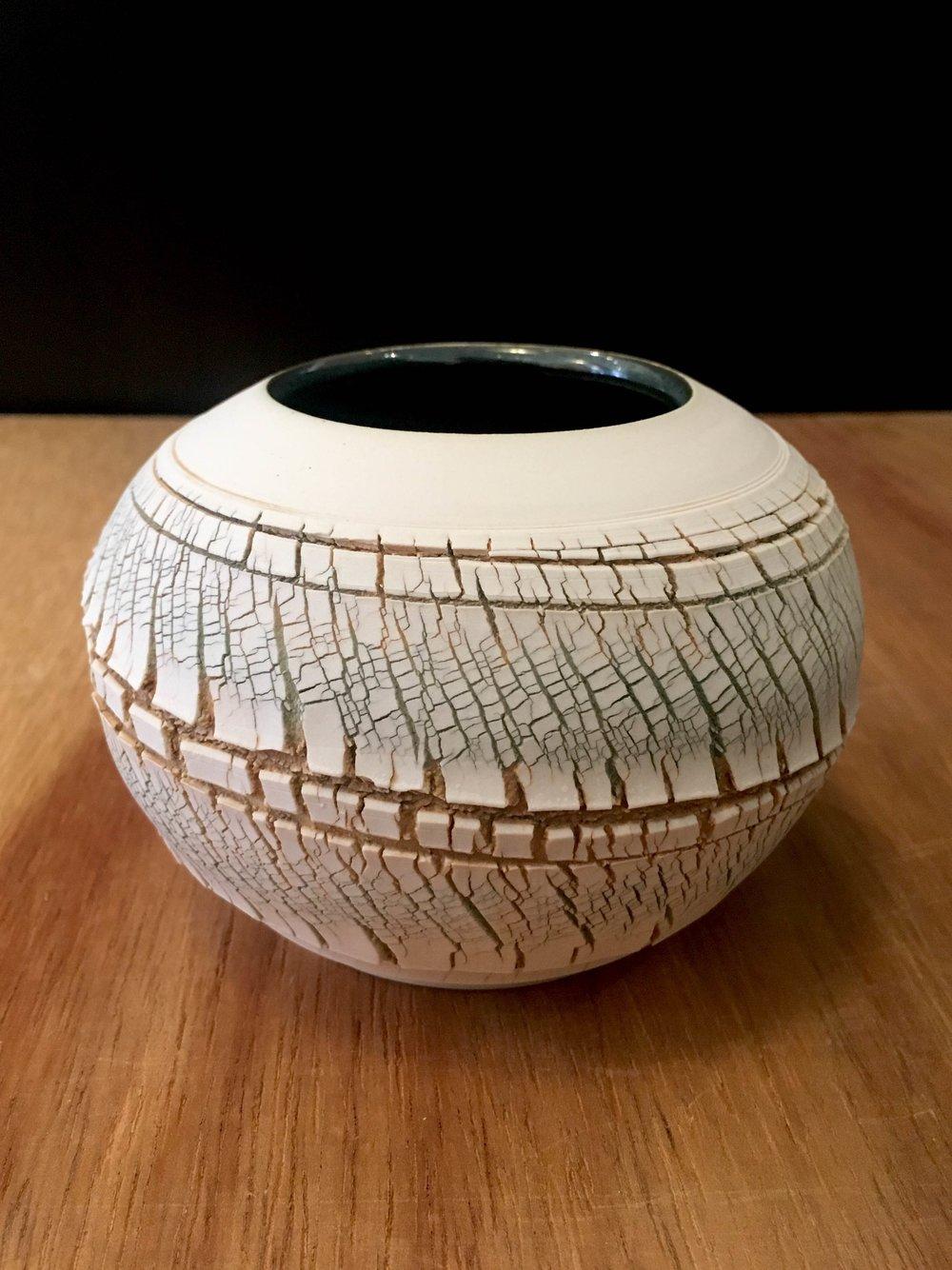 "Small wheel-thrown porcelain sphere, 3"" x 4 1/2"" diameter"