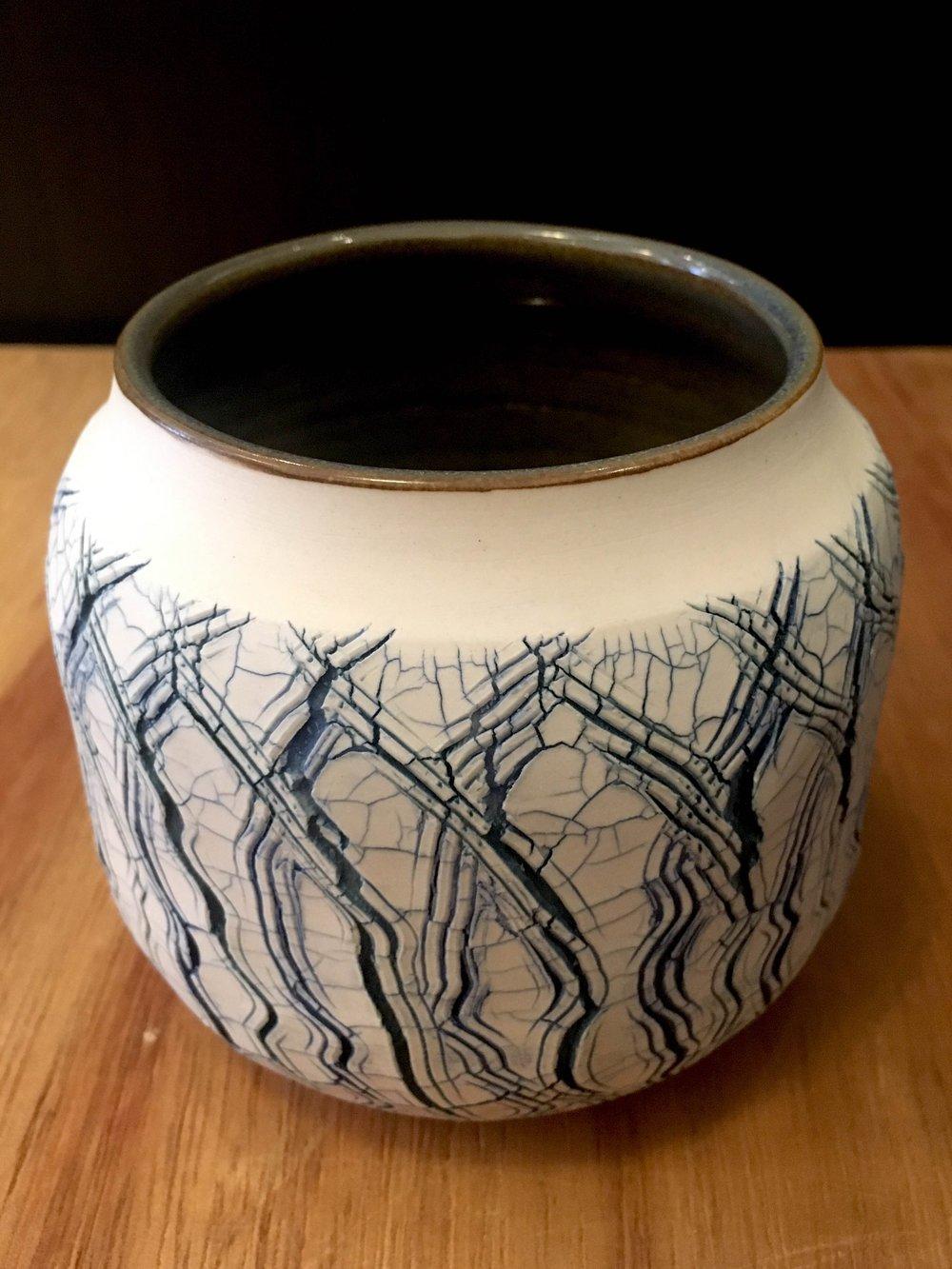 "Small wheel-thrown porcelain open sphere, 4"" x 4 1/2"" diameter, $75"