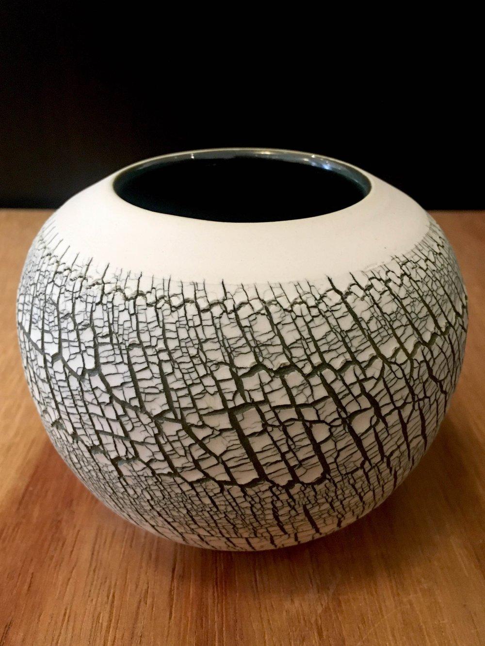 "Small wheel-thrown porcelain open sphere, 3 1/2"" x 4 1/2"" diameter, $55"
