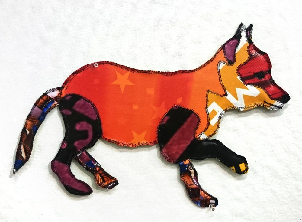 "Rachel Mello ,  Solo Pup , recycled vinyl advertising banners, recycled coroplast, thread, 13 1/2"" x 19 1/2"", $150.  100% of the sale of this piece will be donated to  Arlington Public Arts ."
