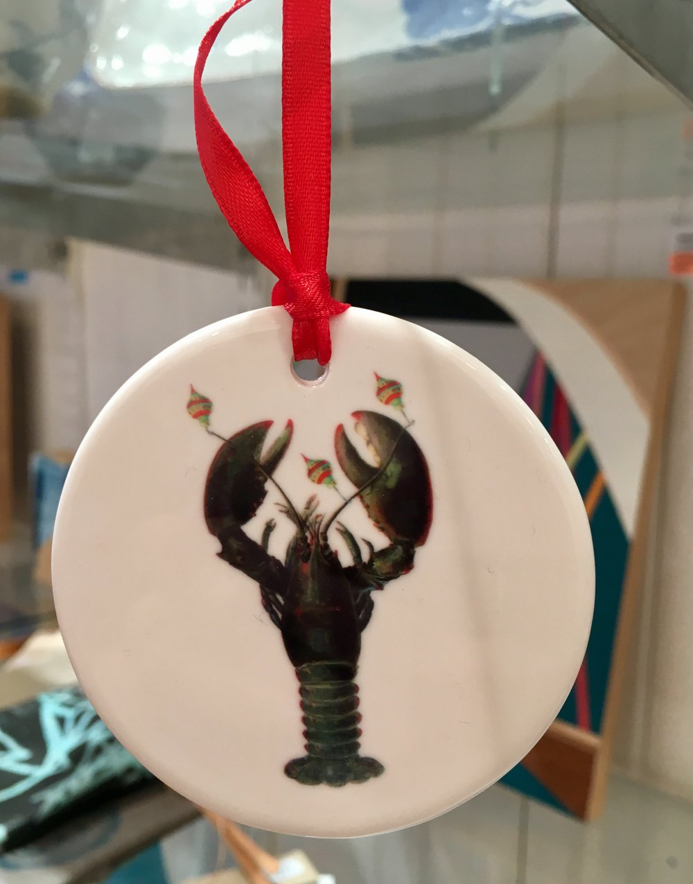 Holiday fish ornaments in assorted images, ceramic, $18