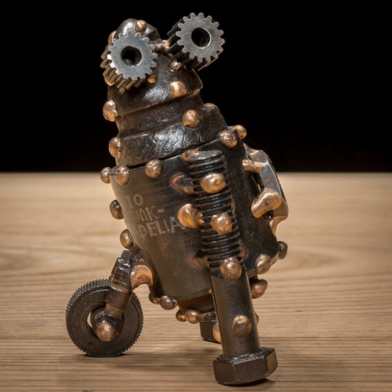 "Io #320 , Neutrino-class astrobot, steel bushing, roto-mill tooth, bicycle parts, bolts, knurling nut, bronze, 3 ½"" x 2 ½"" x 2"", $250"