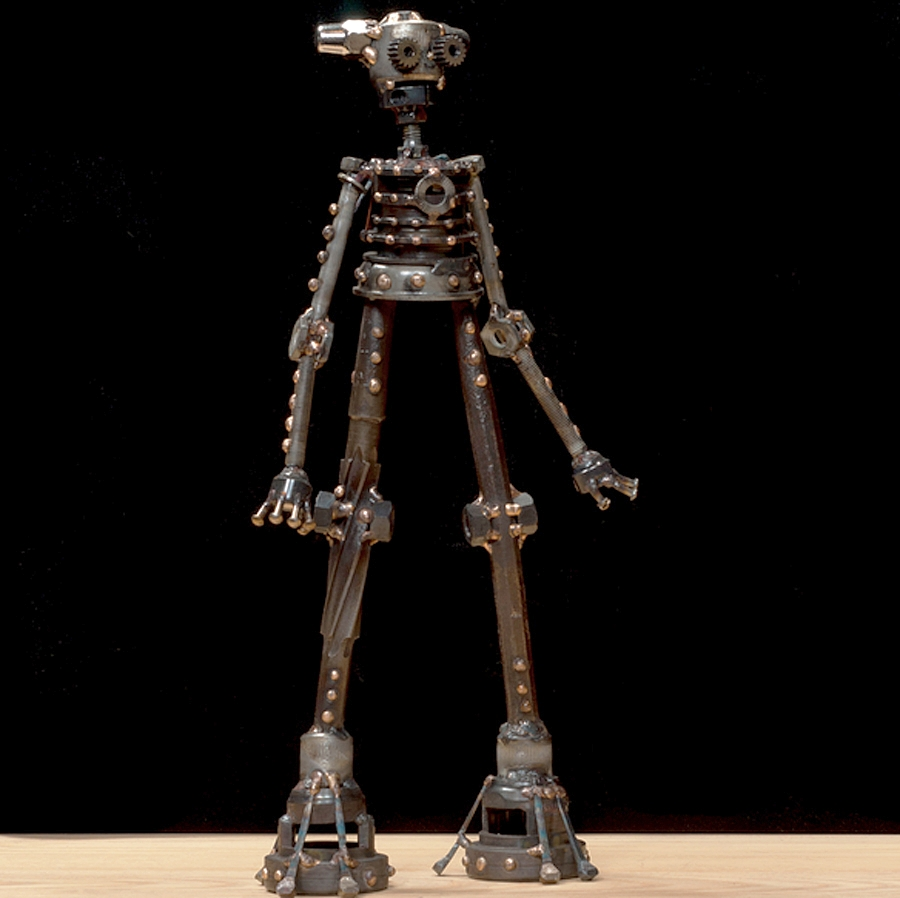 """Bibi #322 , Ion-class astrobot, bicycle parts, socket heads, punch, reamer, rivets, nuts, acorn nuts, bolts, rod clamp, flooring nails, copper, bronze, 15"""" x 8"""" x 3"""", $400"""