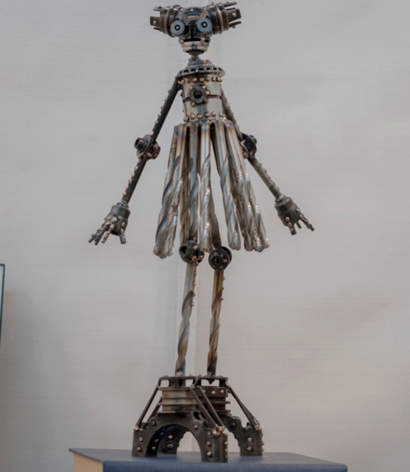 """Sonja #319 , Mercury-class astrobot, re-purposed bicycle parts, drill bits, pillow blocks, flooring nails, washers, bolts, nut, copper, bronze, 21"""" x 12"""" x 7"""", $750"""