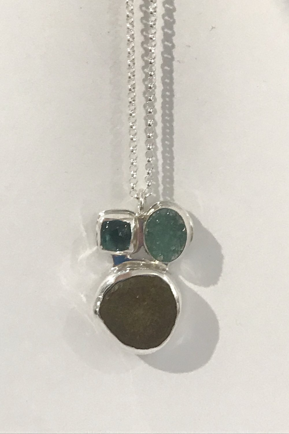 "Beach stone, green dyed druse, and blue/green tourmaline set in sterling silver, with 18"" sterling silver rolo chain, $220"