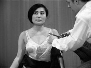Yoko Ono,Cut Piece, 1965