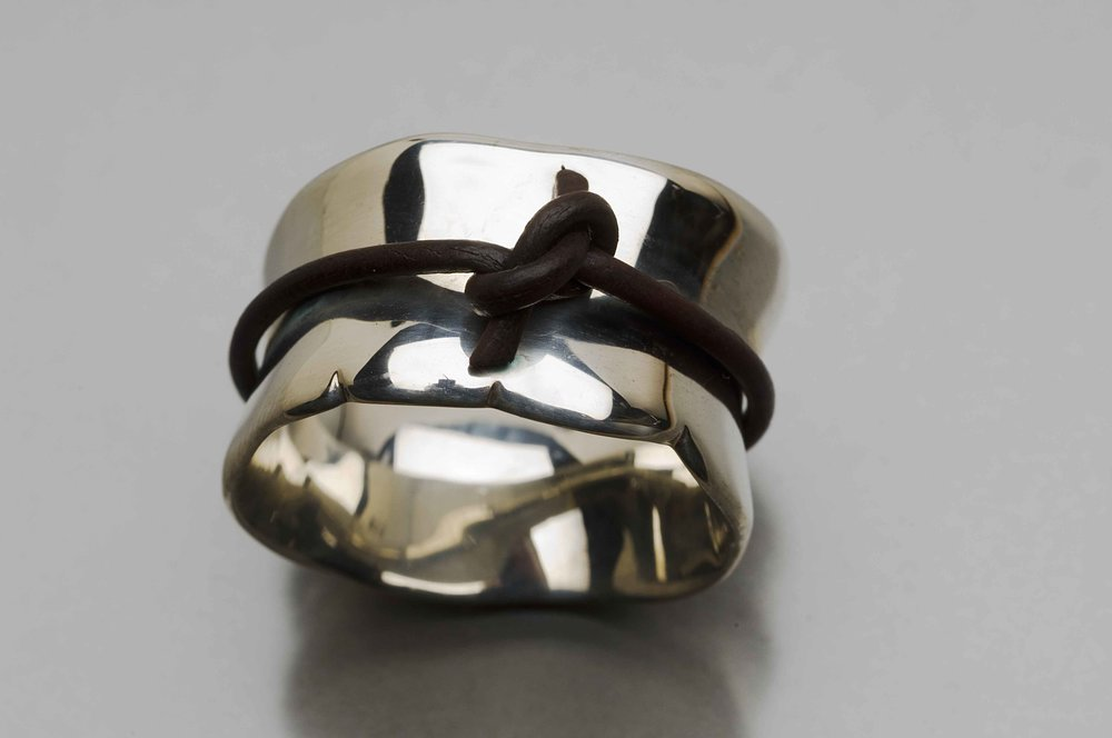 Forget Me Knot ring , sterling silver and leather, size 10, $145