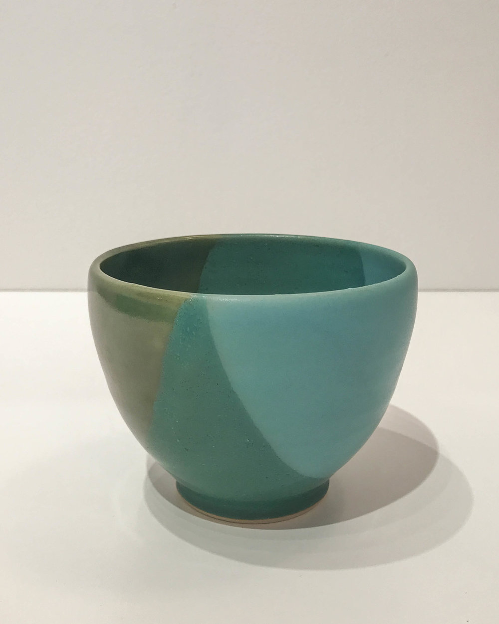 "Jennifer Crowe , small green bowl, hand-thrown stoneware, 3 1/2"" x 4 1/2"", $36"