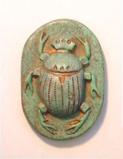 "Scarab #20 , porcelain with acrylic and wax, 3 3/4"" x 2 1/2"" x 1"", $65"