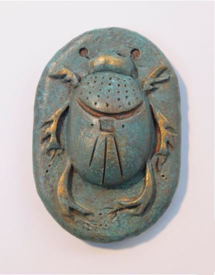 "Scarab #24 , porcelain with acrylic and wax, 3 3/4"" x 2 1/2"" x 1"", $65"