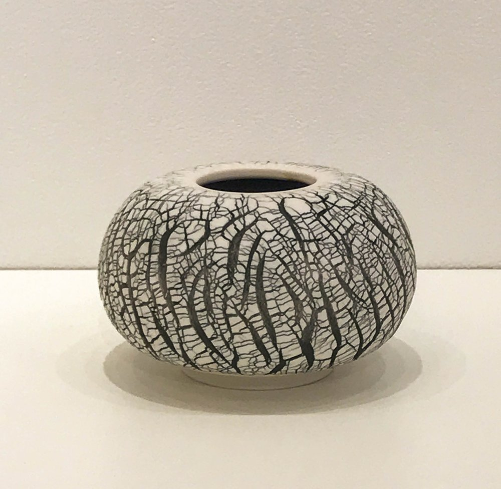 "Small wheel-thrown and hand-altered sphere with black crackle, 4 1/4"" x 4 1/4"" x 2 1/2"", $55"