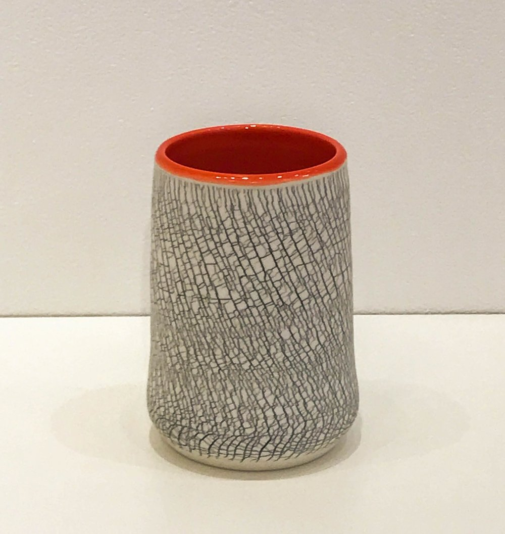 "Wheel-thrown and hand-altered tumbler with black crackle and orange glazed interior, 4 1/2"" x 2 3/4"" x 2 3/4"", $45"