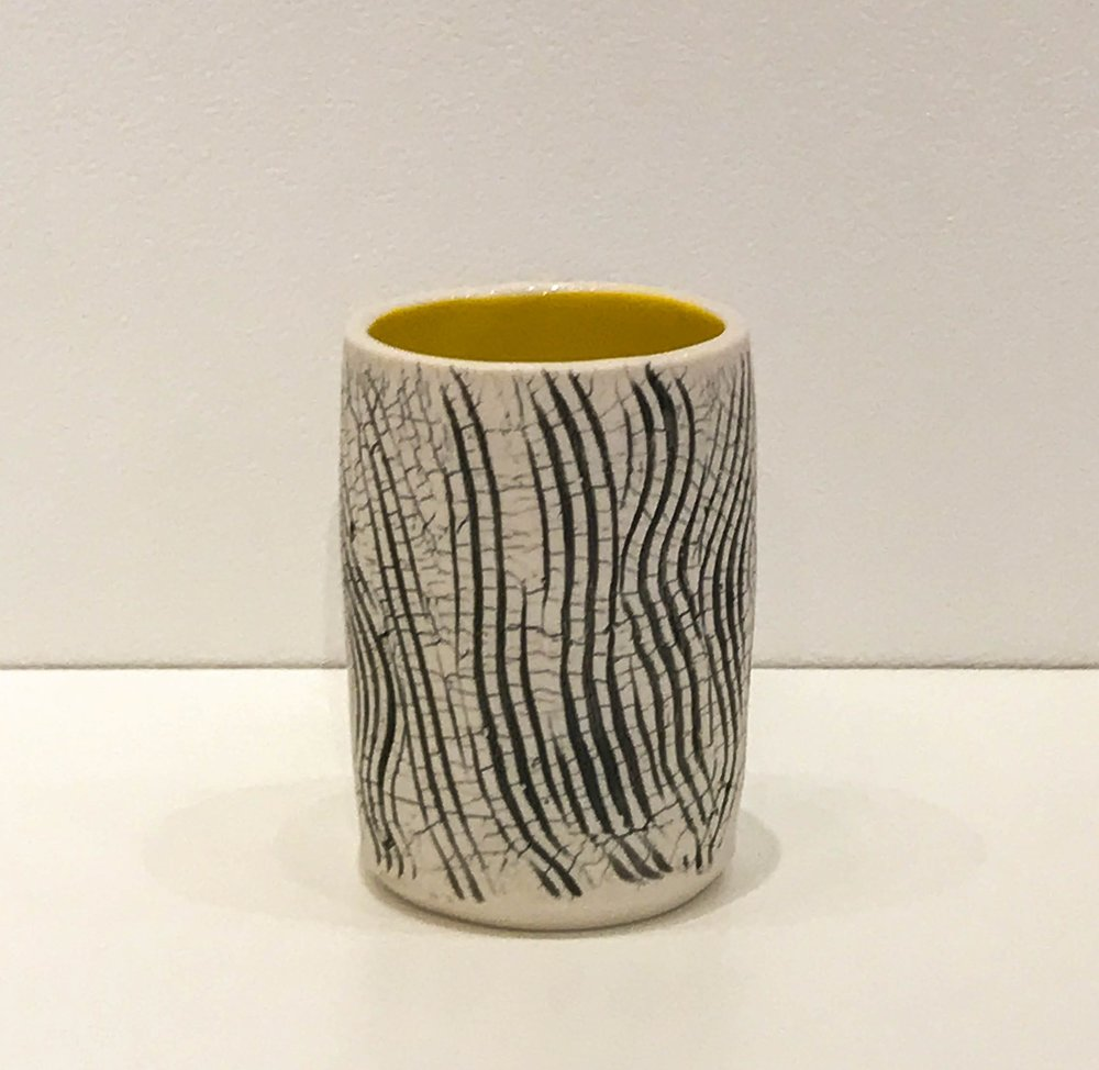 """Wheel-thrown and hand-altered tumbler with black crackle and yellow glazed interior, 4 1/4"""" x 3"""" x 3"""", sold"""