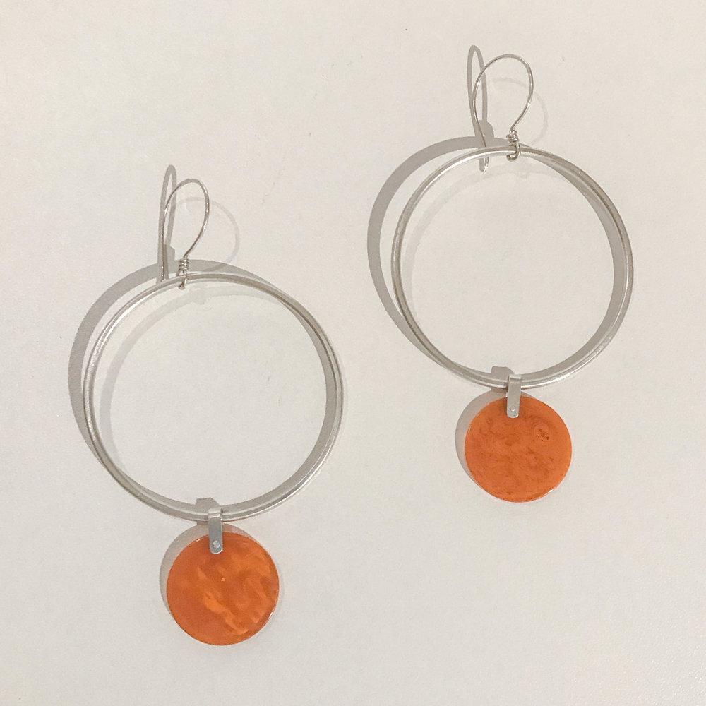 Silver hoop earrings with circles, sterling silver and vintage bakelite, $180