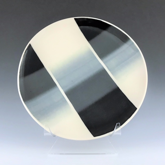 "Black, gray, and white dinner plate, wheel-thrown porcelain with hand-painted ombre design, 1"" x 10 1/2"" x 10 1/2"", $60"