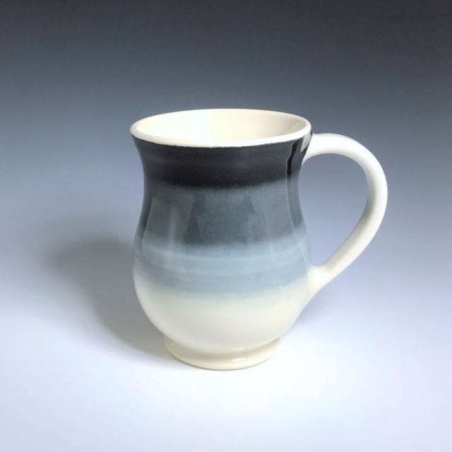 "Black, gray, and white curvy mug, wheel-thrown porcelain with hand-painted ombre design, 5"" x 3 1/2"" x 3 1/2"", $42"