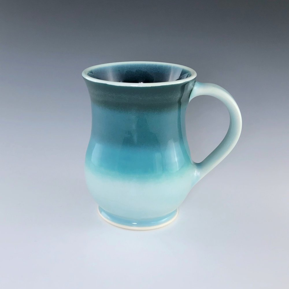 "Teal curvy mug, wheel-thrown porcelain with hand-painted ombre design, 5"" x 3 1/2"" x 3 1/2"", $42"