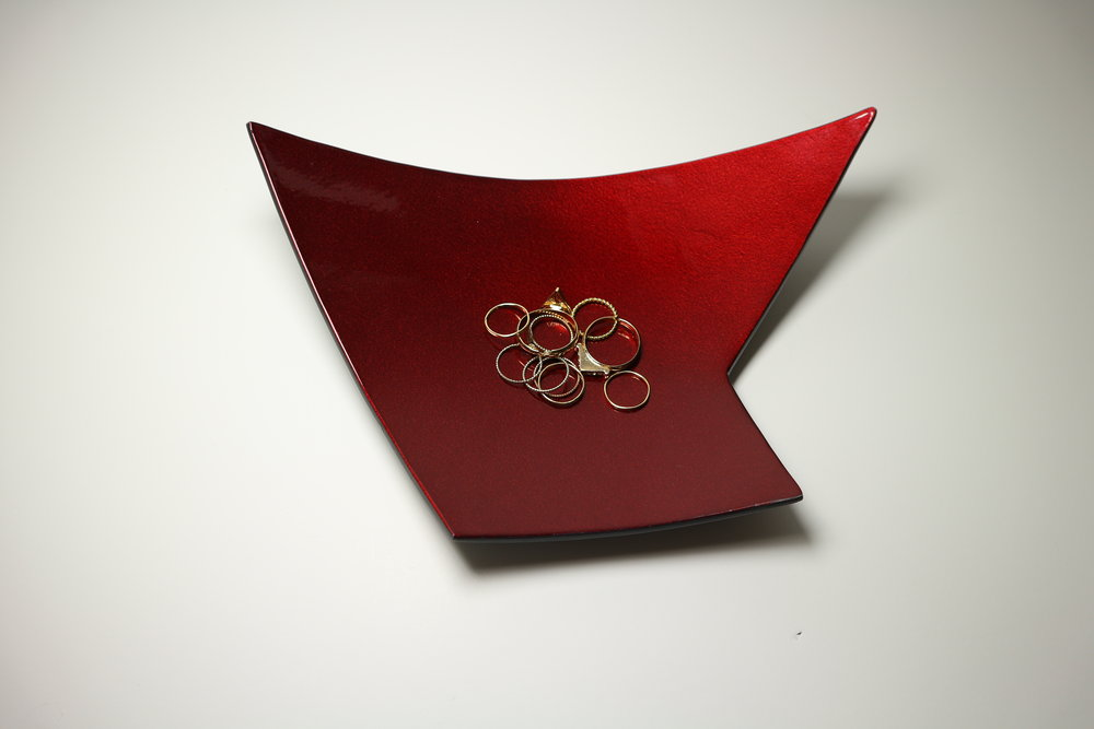 """Accessory Bowl 5 , steel with gun blue patina and red automotive paint, approximately 8"""" x 5"""" x 2"""", $120"""