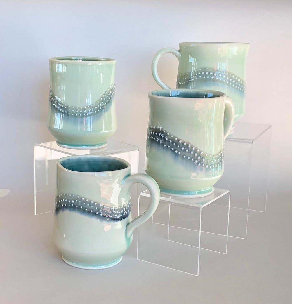 Square mugs, wheel thrown porcelain with slip trail design, $42 each
