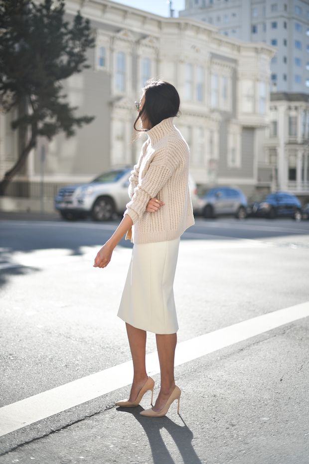 A white turtleneck and sleek pencil skirt scream sophistication.