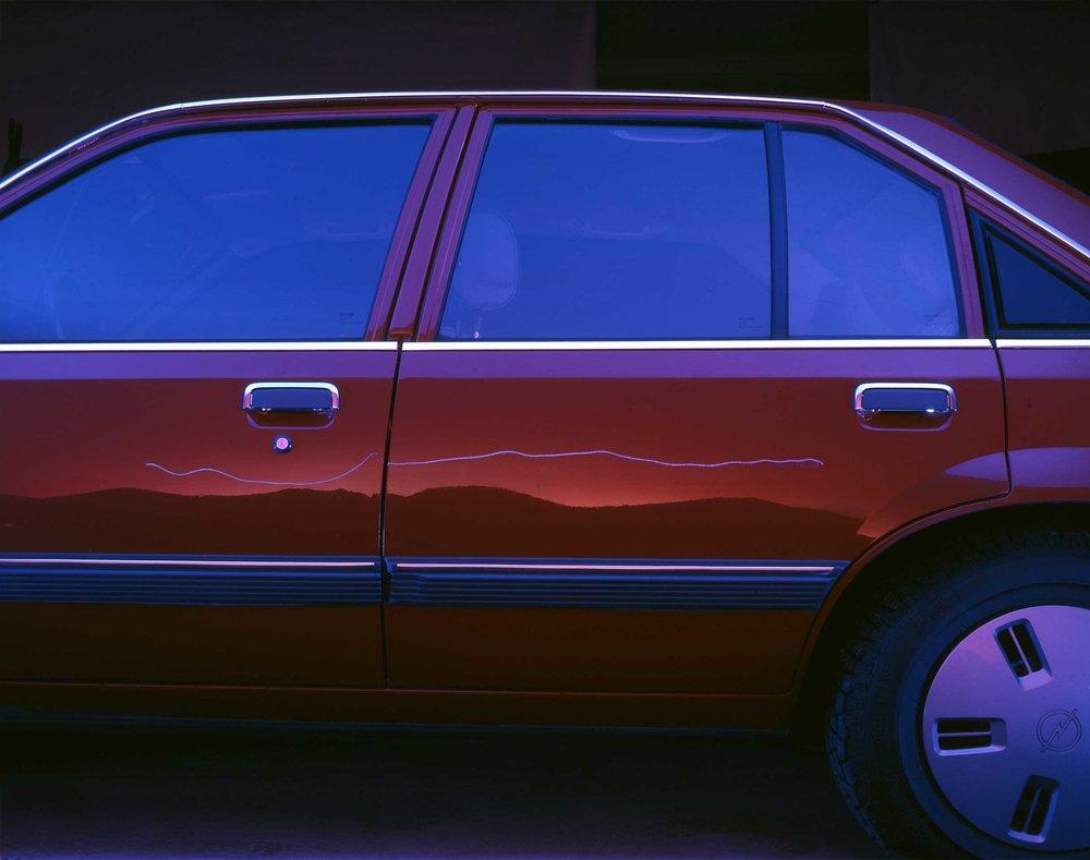red_car_scratch_scandinavian_insurance_company_billboard.jpg