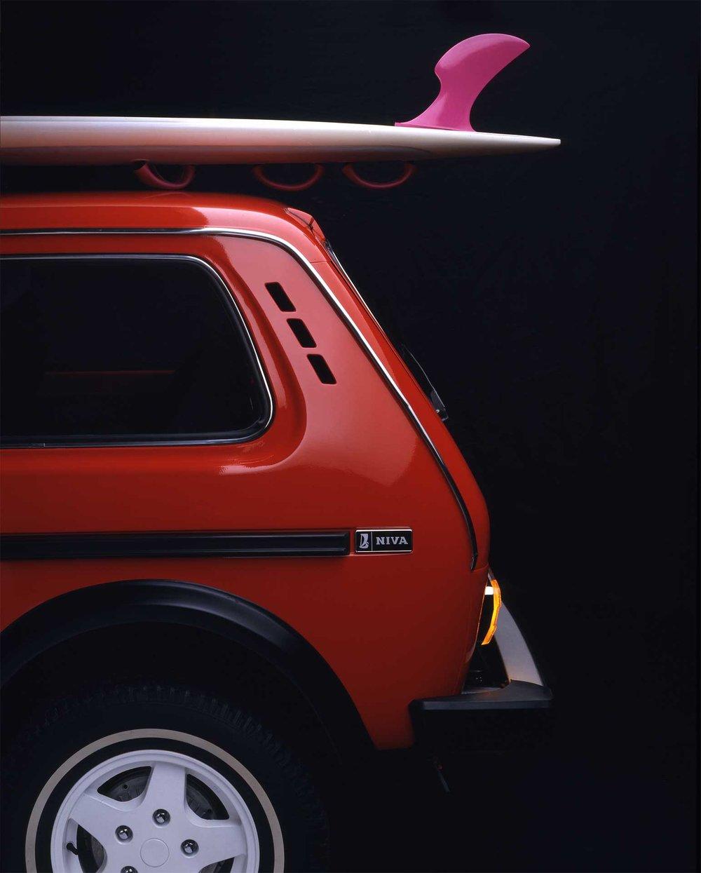 red_car_surfboard_scandinavian_ad_russian_auto_Lada.jpg