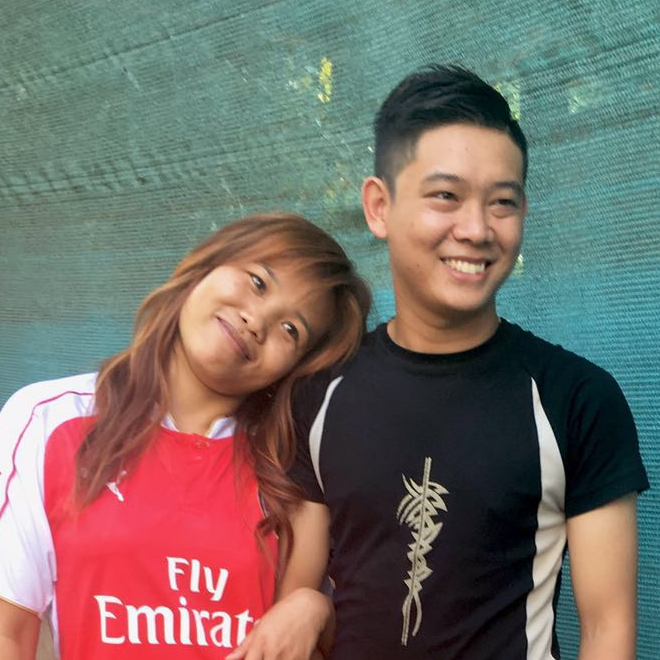 San San Myint and her husband with his haircut by Mackenzie.