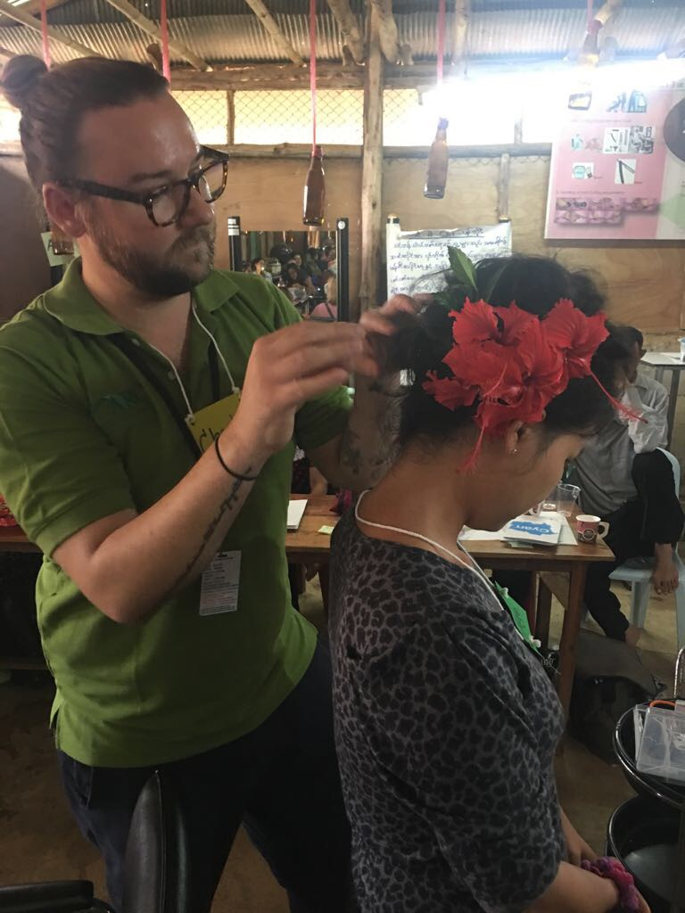 Charlie adds flowers found outdoors at the camp to create a beautiful updo style.